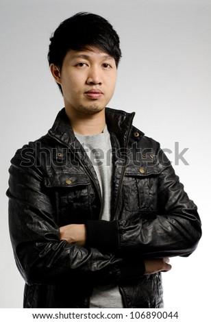 Portrait of an asian man posing - stock photo