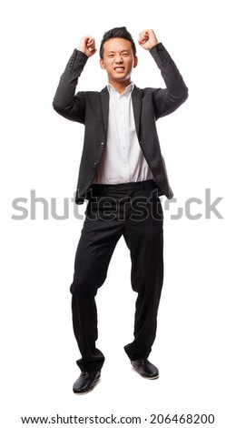 portrait of an asian man with winner gesture - stock photo