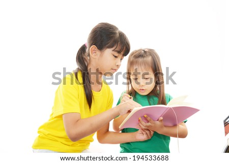 Portrait of an Asian schoolgirls on white background - stock photo