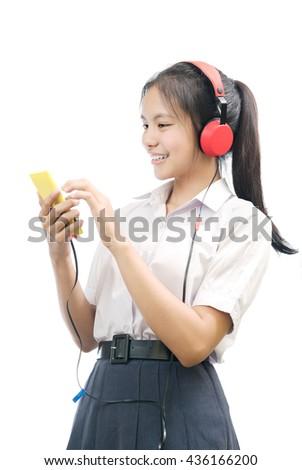 portrait of an Asian student listen to music on white background - stock photo