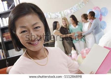 Portrait of an asian woman holding card - stock photo