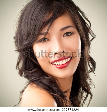 Portrait of an Asian woman smiling.