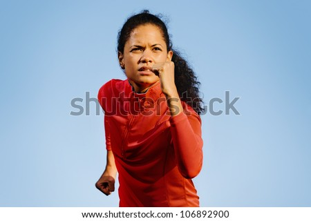 Portrait of an athlete running outdoors. fitness exercise training woman does marathon workout - stock photo