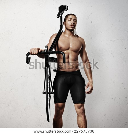 Portrait of an athlete with bicycle - stock photo
