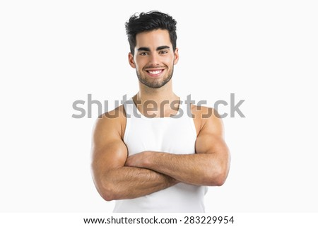 Portrait of an athletic young man smiling, isolated over a white background - stock photo