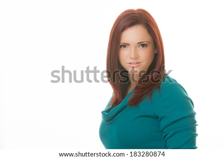 Portrait of an attractie woman wearing green - stock photo