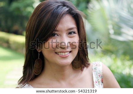 Portrait of an attractive Asian woman. - stock photo