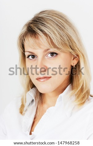 portrait of an attractive blonde girl on a light background - stock photo