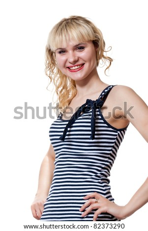 Portrait of an attractive blonde in a striped dress large isolated on white