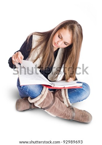 Portrait of an attractive brunette student girl studying. - stock photo