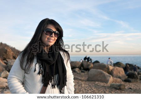 Portrait of an attractive brunette woman with intentional lens or sun flare. - stock photo