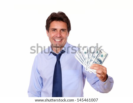 Portrait of an attractive business man holding up cash dollars against white background
