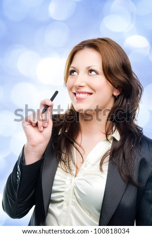 Portrait of an attractive business woman dreaming   with blue lights in the background - stock photo