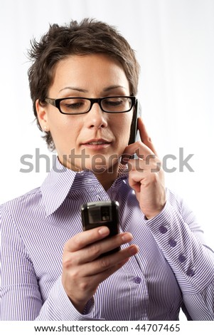 Portrait of an attractive businesswoman using mobile phones - stock photo