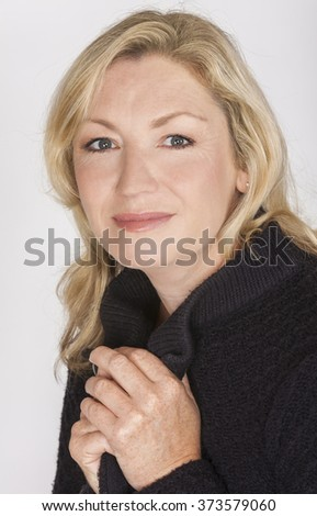 Portrait of an attractive elegant middle aged woman relaxing