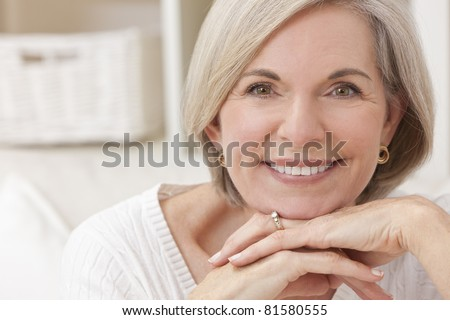 Portrait of an attractive elegant senior woman relaxing at home. - stock photo