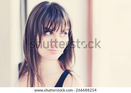 Portrait of an attractive fashionable young brunette woman.  Instagram style filtred image - stock photo