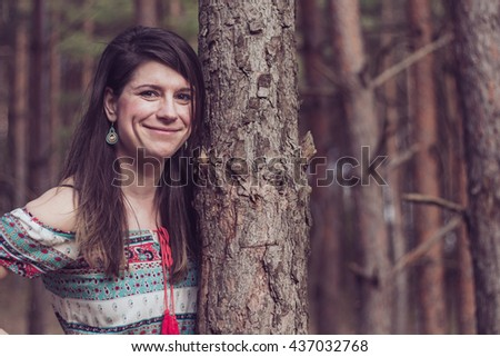 Portrait of an attractive fashionable young girl hugging a tree shoving her espousal of ecological enviroment - stock photo
