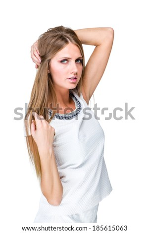 Portrait of an attractive fashionable young woman against isolated white background