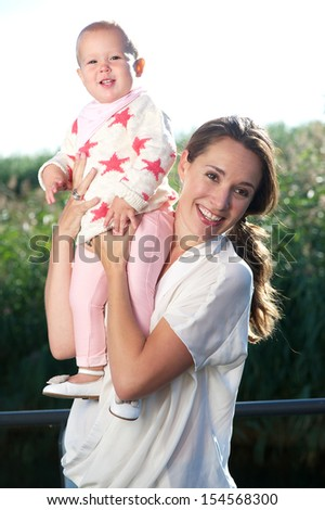 Portrait of an attractive female smiling with happy baby