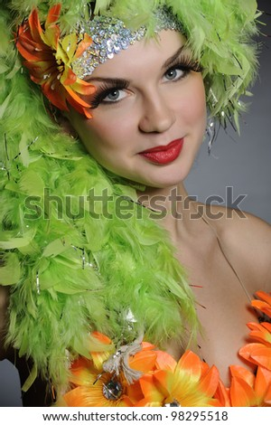 Portrait of an attractive girl in fancy dress on dark background