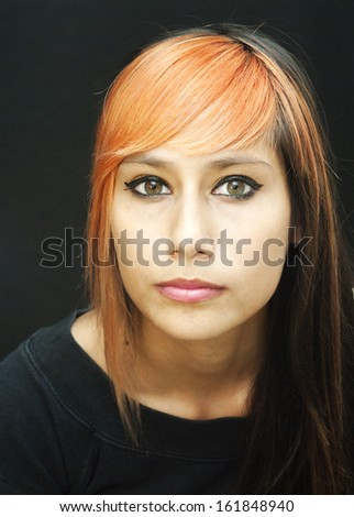 Portrait of an attractive girl on black background