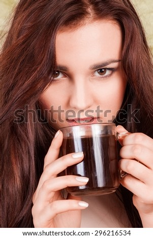 portrait of an attractive girl with a cup of coffee - stock photo
