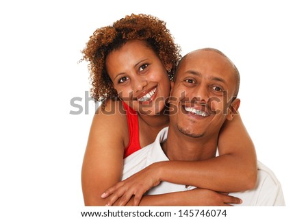 Portrait of an attractive, happy young African American couple. Isolated On White