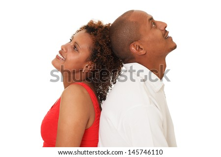 Portrait of an attractive, happy young African American couple. Isolated On White - stock photo