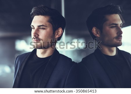 Portrait of an attractive man, model of fashion, wearing modern suit.