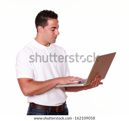 Portrait of an attractive man on white t-shirt working on his laptop on isolated studio