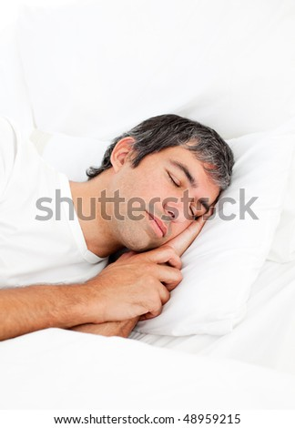 Portrait of an attractive man sleeping in his bed