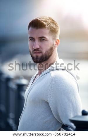 Portrait of an attractive man with beard in berlin - stock photo