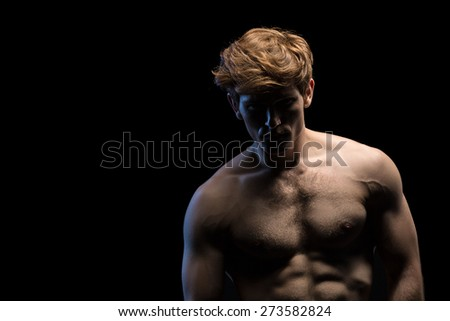 Portrait of an attractive man with naked torso - stock photo