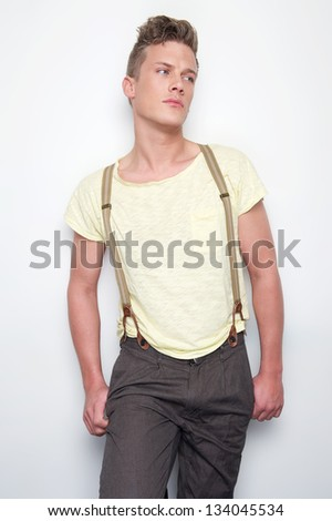Portrait of an attractive man with suspenders - stock photo