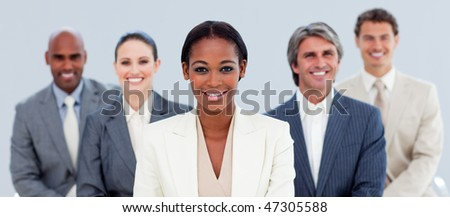 Portrait of an attractive manager and her team  standing