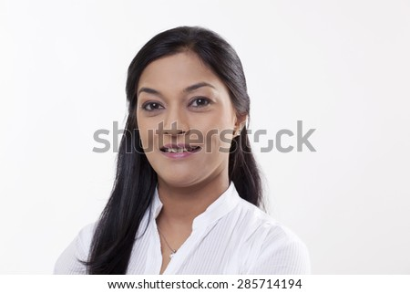 Portrait of an attractive mid adult woman smiling - stock photo