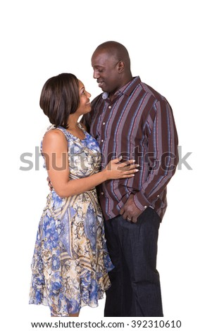 Portrait of an attractive middle aged couple looking at each other interacting - stock photo