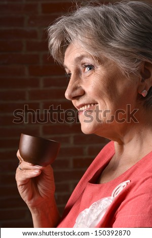 Portrait of an attractive middle-aged woman at home