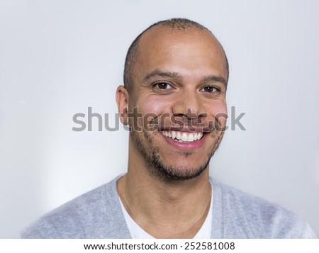 Portrait of an attractive mixed race man smiling to camera - stock photo