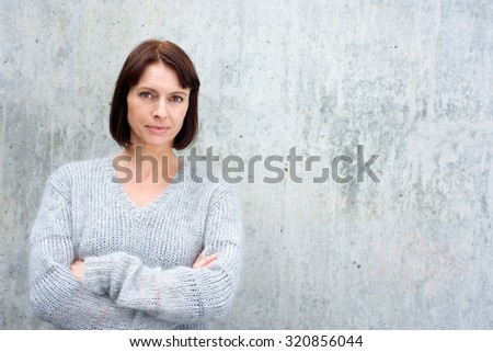Portrait of an attractive older woman in wool sweater - stock photo
