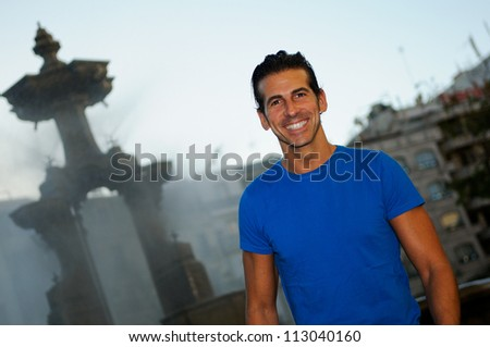 Portrait of an attractive smiling man in urban background
