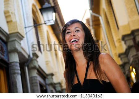 Portrait of an attractive smiling woman in urban background