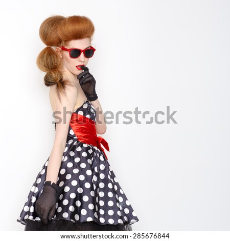 Portrait of an attractive smiling young woman in sunglasses. Retro style. Copyspace on right. - stock photo
