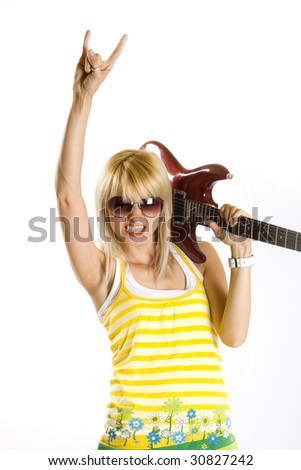 portrait of an attractive woman guitarist making a rock sign
