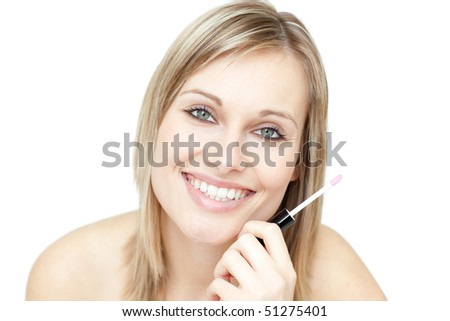 Portrait of an attractive woman holding a lipstick against a white background