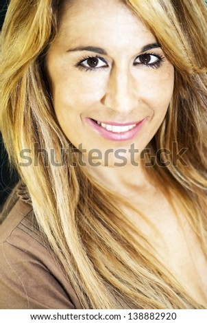 Portrait of an attractive woman isolated on black background