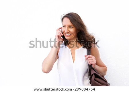 Portrait of an attractive woman with bag using cell phone