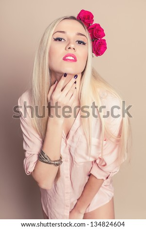Portrait of an attractive woman with roses in beige