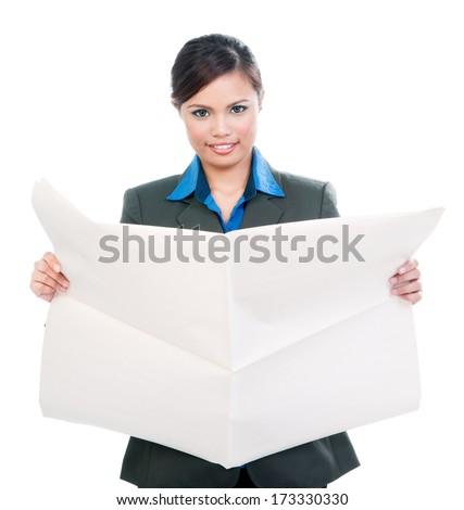 Portrait of an attractive young Asian businesswoman holding blank newspaper over white background
